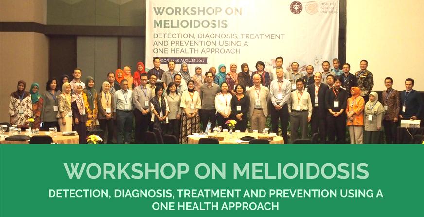 Foto bersama panitia, peserta dan narasumber Workshop on Melioidosis